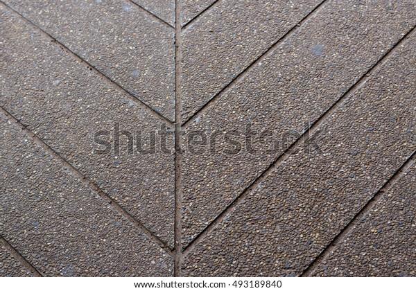 Tiny stone concrete walkway texture.