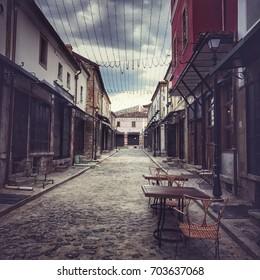 Tiny street of historical Korca, the Old Ottoman Bazaar, Albania. Sightseeing in Albania.