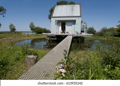 A tiny summer house on the water
