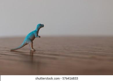 Tiny toy dinosaur.