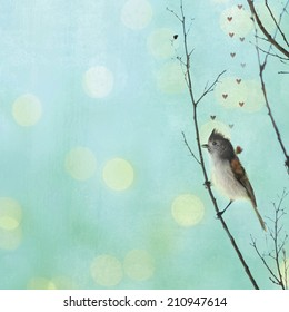 A tiny Tuffted Titmouse bird waits patiently for love on a branch with a teal textured background of white and yellow bokeh and floating pink hearts..