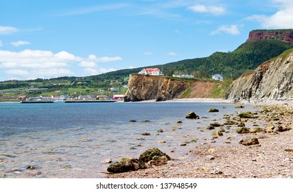 The tiny village of Perce is on the southern coast of the Gaspe Peninsula in Quebec. This photo was taken from the shore near Perce rock.