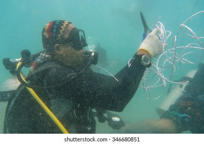 TIOMAN ISLAND, MALAYSIA - 10 JUN 2015 : Marine biologist doing underwater work at newly planted artificial reef on Jun 10.