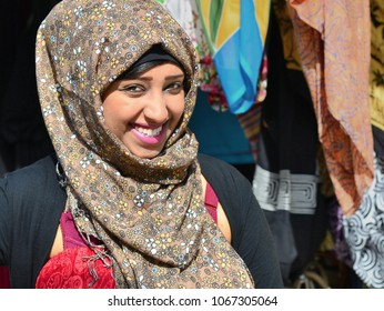 TIOMAN ISLAND, MALAYSIA - MARCH 4, 2013: Young Kuwaiti woman wears a floral-pattern hijab over her risque red dress and poses for the camera, on March 4, 2013.