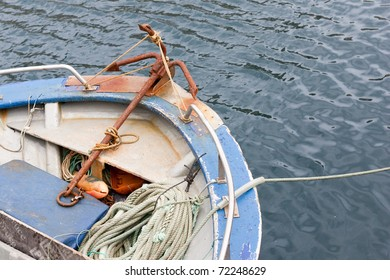 Tip of a fishing boat at anchor