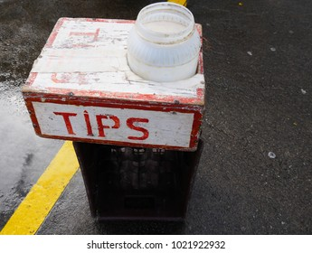 Tip jar in a box by the road side placed by street performers