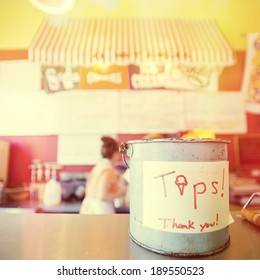 Tip jar in a colorful ice cream shop, instagram style filter