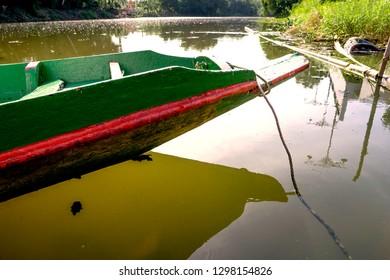 tip of a sampan moored