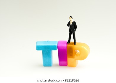 Tip word and toy business man