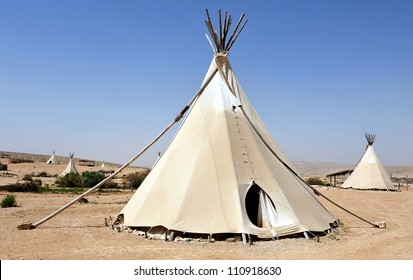 Tipi, teepee, tepee tents - North American Indian tent in the desert. No people. Copy space