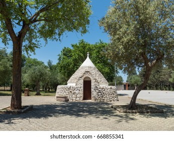 Tipical trulli house among green plants and flowers, main touristic district, Apulia region, Southern Italy