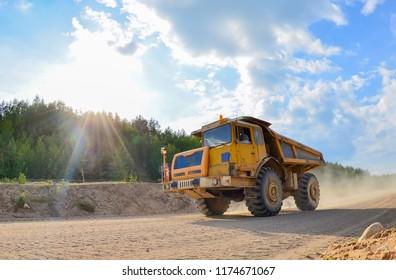 Tipper. Belaz. Career. Yellow mining truck. Supersize car