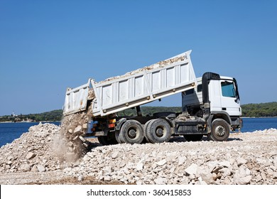 tipper truck unload crushed rocks