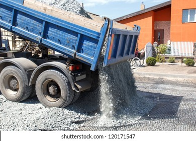 tipper truck unload crushed stone. New street building