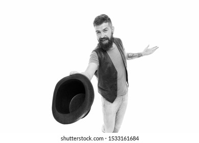 Tipping his hat as a salutation. Cheerful man greeting with hat. Bearded hipster in casual attire holding classic black hat. His hat etiquette game is up to standard.