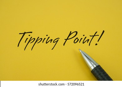 Tipping Point! note with pen on yellow background