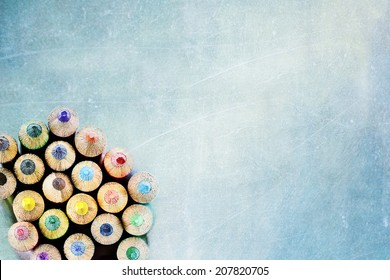 Tips of coloring pencils over a textured background. Extreme shallow depth of field.