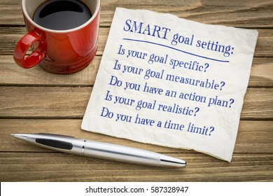 tips and questions on SMART goal setting - handwriting on a napkin with a cup of coffee