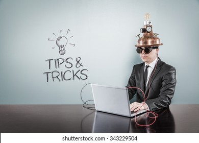 Tips and tricks concept with vintage businessman and laptop at office