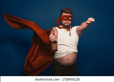 Tipsy Or Drunk Superhero Holding Bottle Of Wine, Man In Superhero Costume Ready For Feats Figuratively Holding Bottle Of Wine In One Hand Shows A Fist With The Other Hand Cut Out On Blue Background