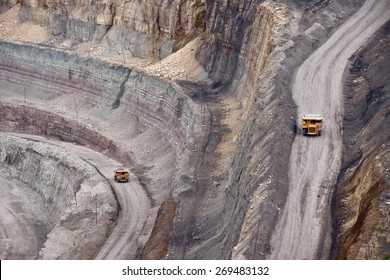 Tip-trucks on the road in open mine