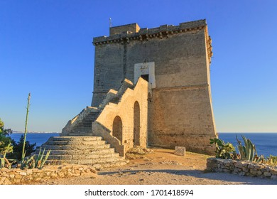 Tipycal Coastal Watchtowers of Apulia: historical fortification Dell'Alto tower. Santa Maria dell'Alto is a coastal tower of Salento, located in the Municipality of Nardò in Italy.