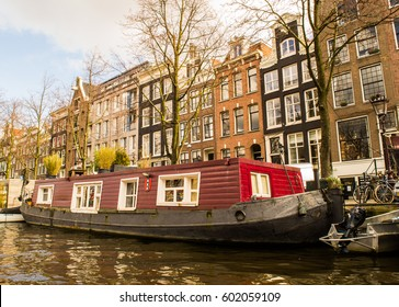 Tipycal Houseboat in Amsterdam/ Houseboat on water, Amsterdam