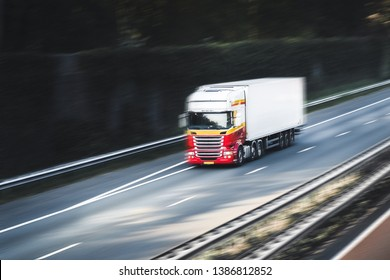TIR, track rushing on the highway or street, motion blur, eminent menace