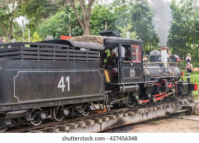 Tiradentes, Brazil, Dec 30, 2015: Old May Smoke train in Tiradentes, a Colonial Unesco World Heritage city. The train standing on a rotating switch, used to maneuver it in the correct direction