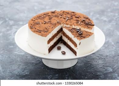 Tiramisu cake - Classical dessert with mascarpone and coffee .