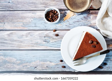 Tiramisu cake decorated with coffee beans with coffee drink. toning. selective focus