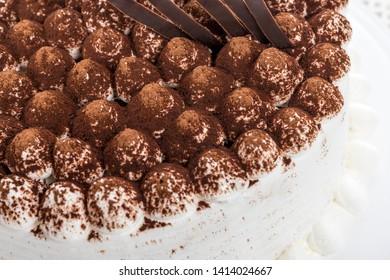 Tiramisu cake decoration detail and whipped cream on the side