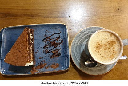 Tiramisu Cake (dessert consisting of layers of sponge cake soaked in coffee with powdered chocolate and mascarpone cheese) and Cup of Salep (starchy preparation of the dried tubers of various orchids)