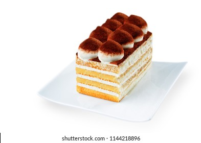 Tiramisu cake on a white plate isolated. toning. selective focus