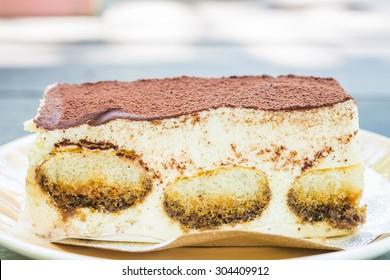 Tiramisu cake on wooden table background ,Closeup