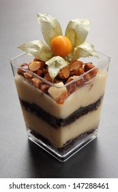 Tiramisu with crushed roasted nuts in glass cup