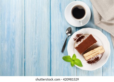 Tiramisu dessert and coffee on wooden table. Top view with copy space