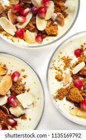 Tiramisu dessert in glasses with pomegranate and biscuit