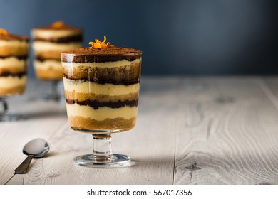 Tiramisu dessert on a grey wooden rustic table