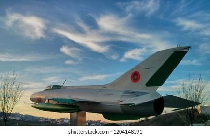 Tirana, Albania - February 16 2014: Former Albanian Airforce Mig-21 on pedestal (Chinese license-built version, J-7)