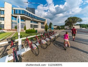 Tirana, Albania - June 1, 2018: Bike renting point on Deshmoret boulevard in Tirana.