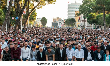 TIRANA, ALBANIA - JUNE 15, 2018: Prayers in the early morning hours are praying for Eid al-Fitr occupying the main boulevard in Tirana