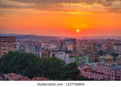 Tirana, Albania - June 2018: Areal cityscape view of Tirana city center at sunset. Modern Architectural buildings and urban photography in Tirana, the capital of Albania, Southeastern Europe