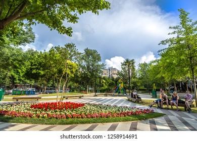 Tirana, Albania - June 2nd 2018 - The local people of Tirana enjoying the tidy boulevard with flowers in Tirana