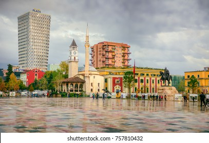 Tirana, Albania. November 12, 2017: Newly reconstructed city central Skanderbeg square, citizens walking at pedestrian zone.