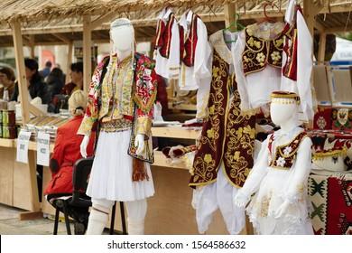 Tirana, Albania. November 2019: Traditional market in Tirana, Albania. National Albanian costume as souvenir for sale.