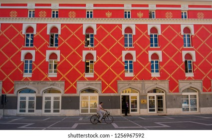 TIRANA, ALBANIA - October 19, 2018: View from central Tirana: The government building of the Ministry of Urban Development and Tourism. Red orange house. Ministry of Agriculture