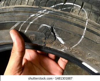 Tire burst. Broken tire. Damaged tire after tire explosion at high speed on highway.