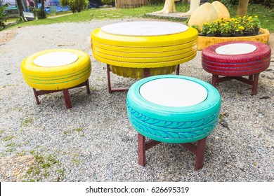 Tire Chair Recycle in Garden,Reuse Tire for Playground,Used Rubber Car Tyres wheel decoration in Park,Colorful Recycle Toy,Be save Environment Idea,Add value change Reuse Concept.