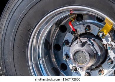 Tire and rim of the big rig semi truck wheel with a professional electronic system for monitoring, adjusting and pumping the nominal tire pressure for safe movement and delivery of goods